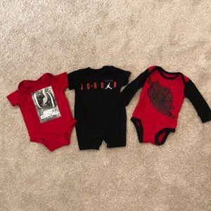 Three pieces of Air Jordan baby clothes